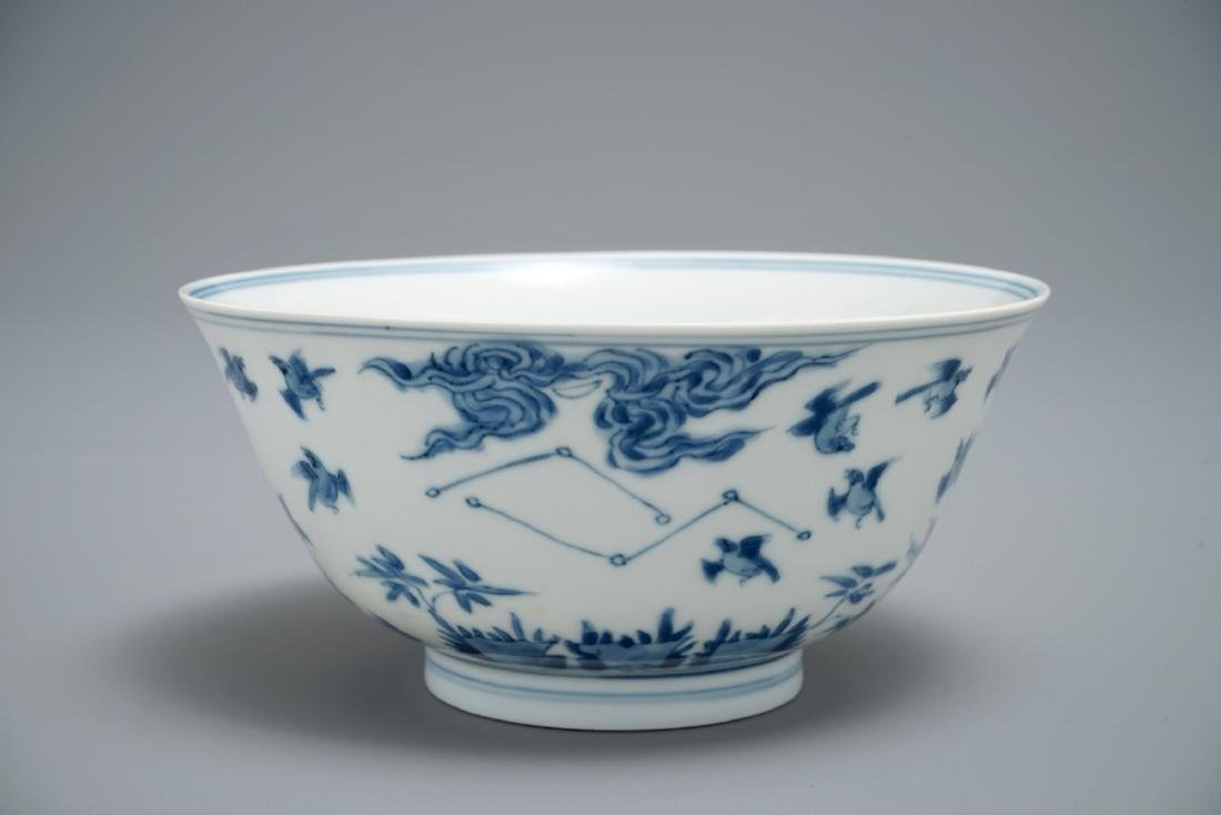 A Chinese blue and white bowl with birds among foliage,