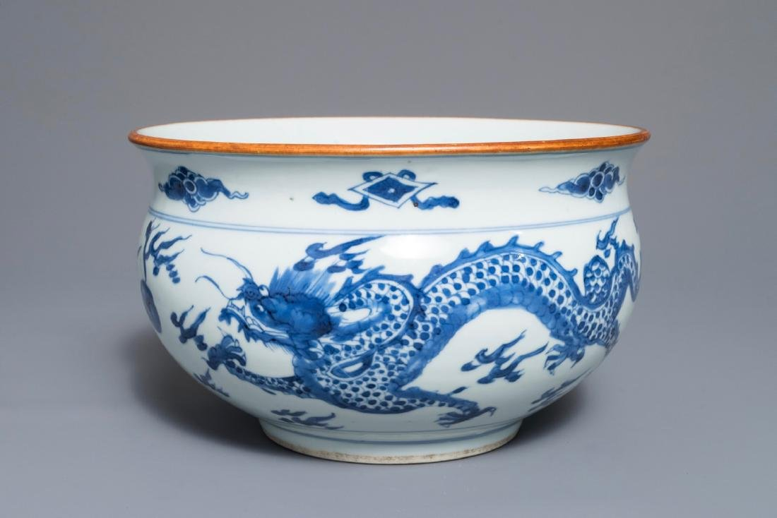 A blue and white Chinese censer with dragons chasing