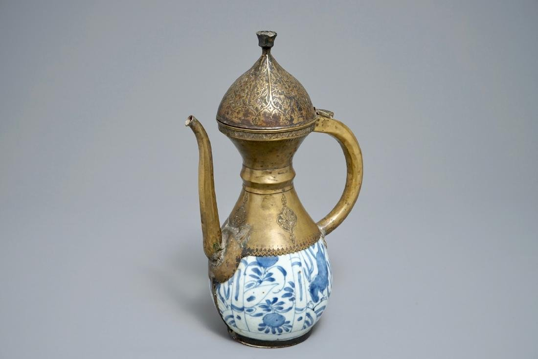 A Chinese blue and white bottle vase with Islamic brass