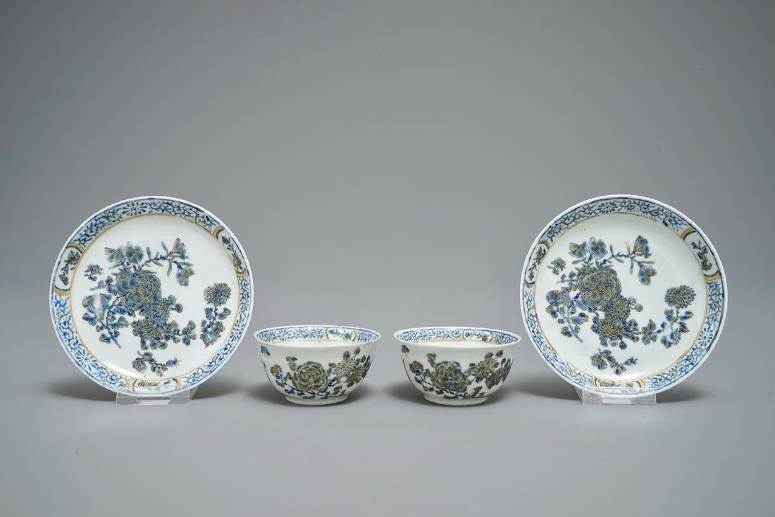 A pair of Chinese eggshell cups and saucers with