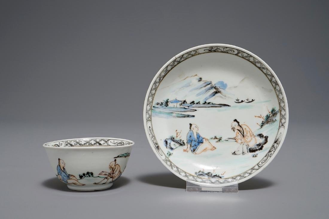 A Chinese cup and saucer with two figures in a