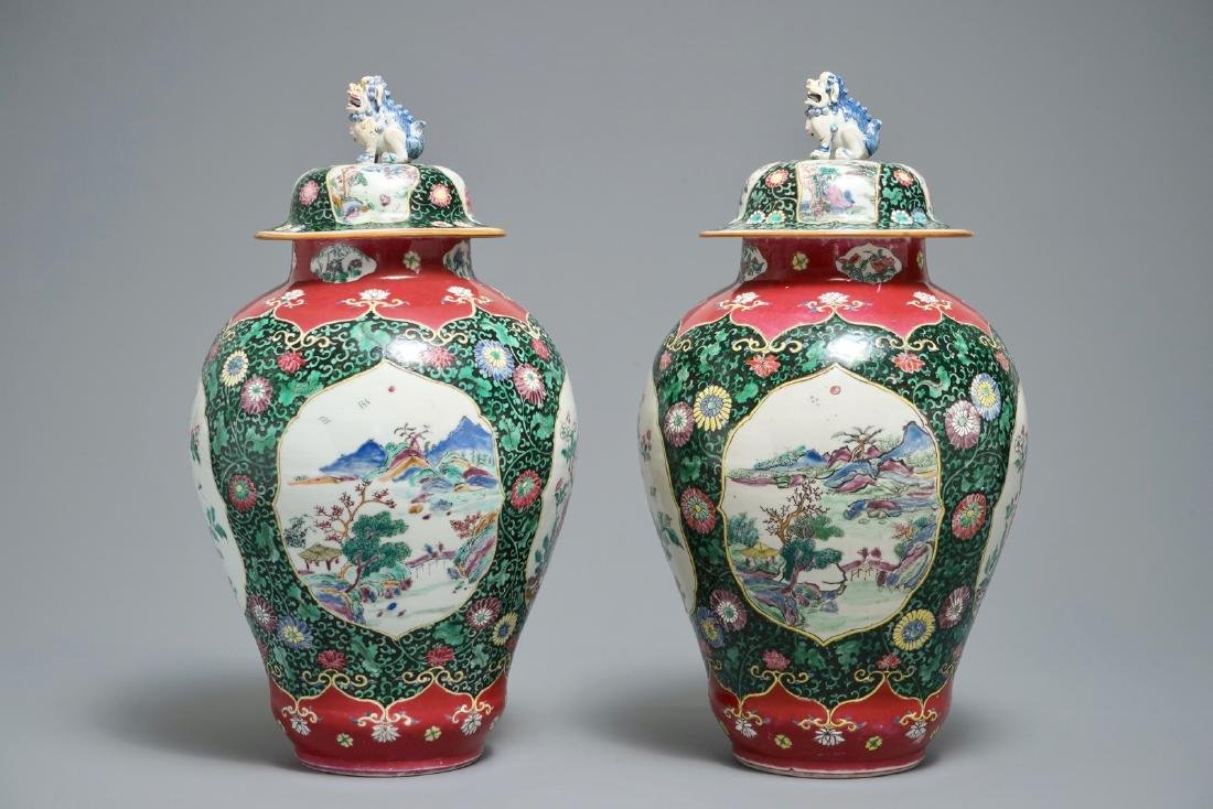 A pair of Chinese famille rose black-ground vases and