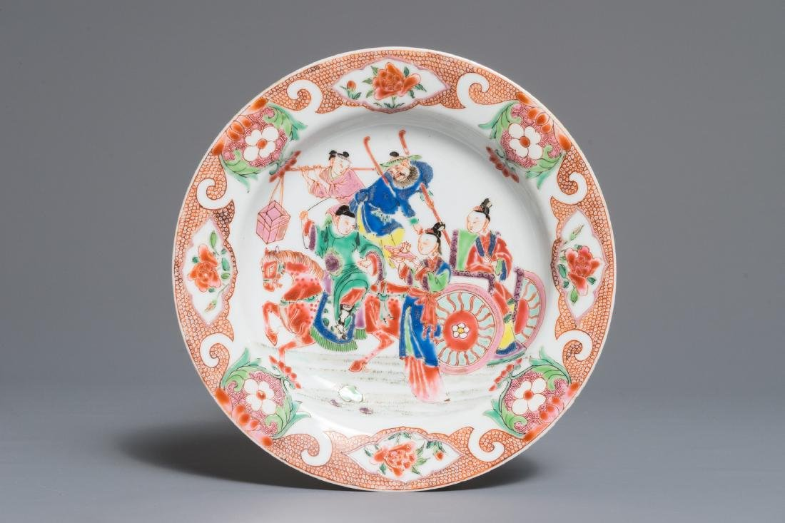 A Chinese famille rose plate with figures around a