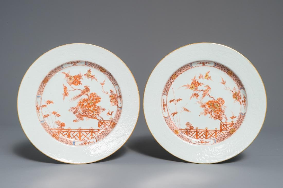 A pair of Chinese iron red and gilt plates with