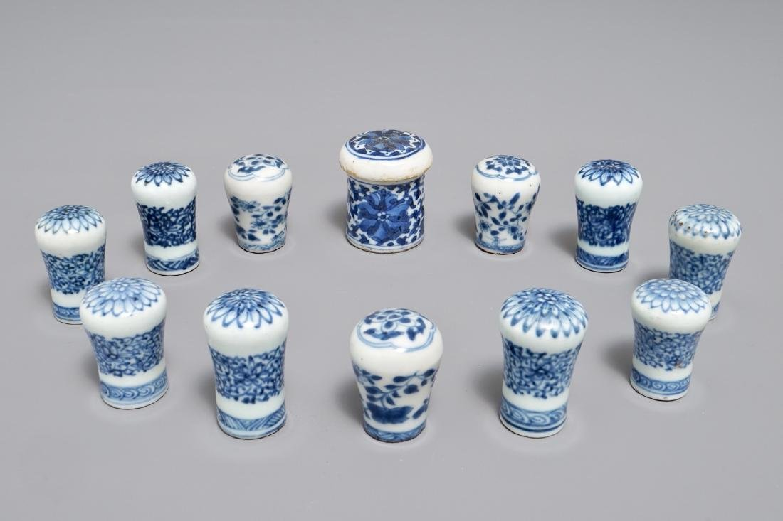 Twelve Chinese blue and white cane handles or scroll