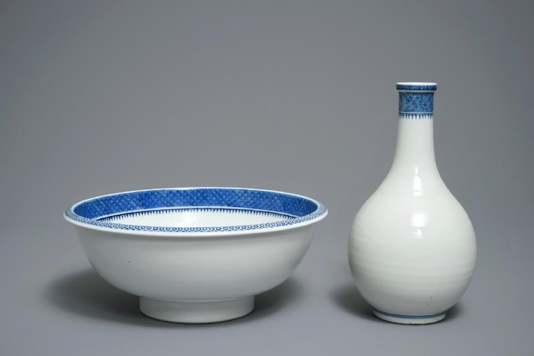 A Chinese blue and white basin with water bottle,