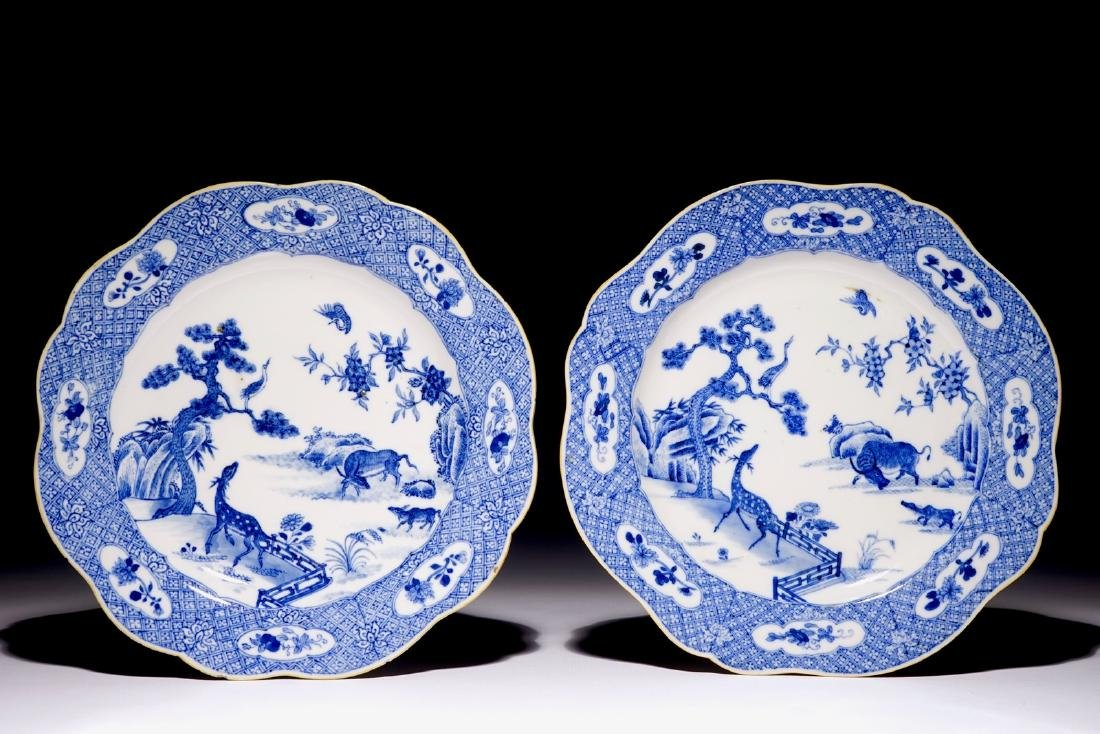 A pair of Chinese blue and white plates with animals in