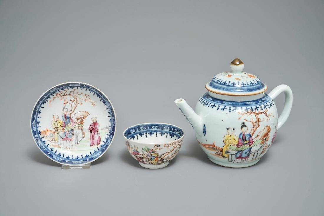 A Chinese famille rose mandarin teapot with cup and
