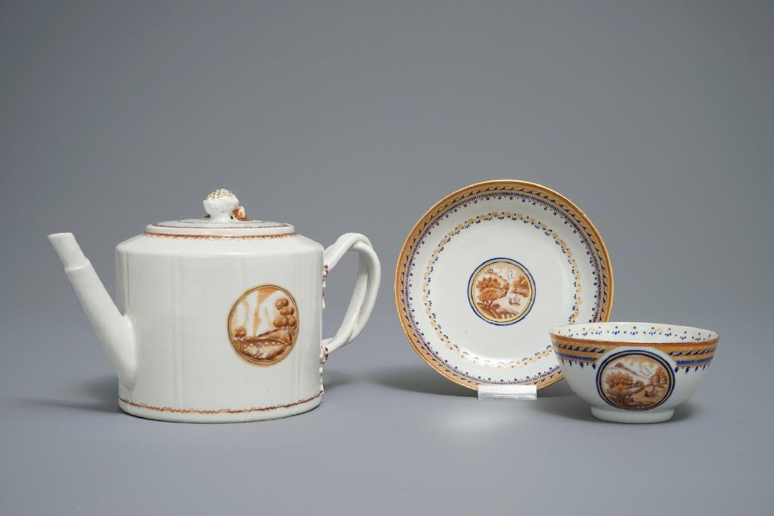 A Chinese export porcelain teapot with matching cup and