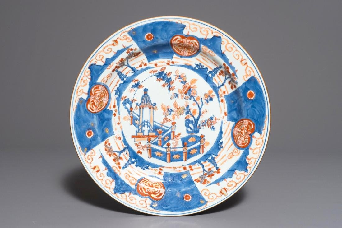 A large Chinese Imari-style charger with a pagoda in a