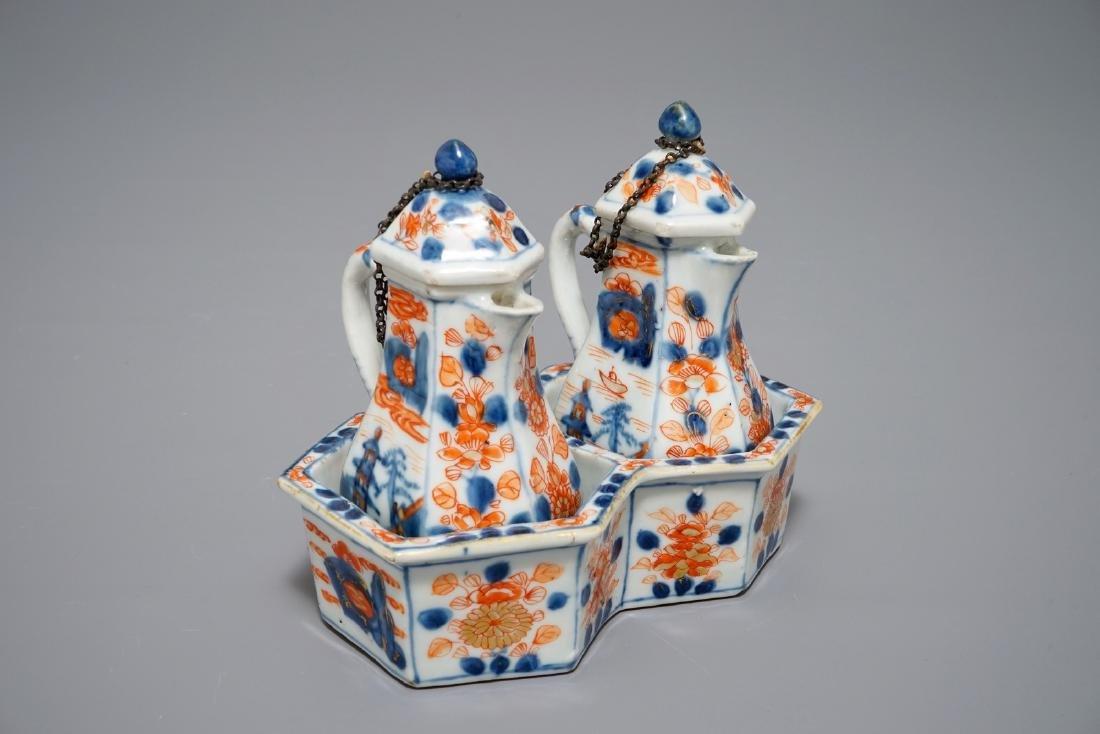 A Chinese Imari style cruet set on stand, Qianlong
