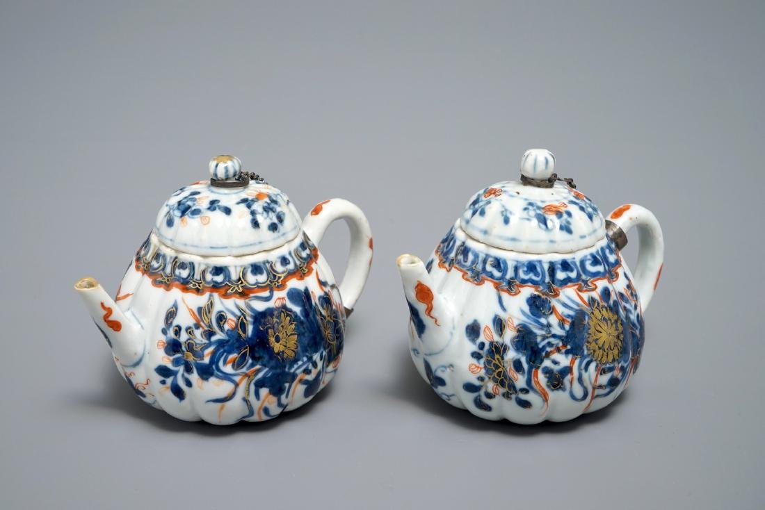 A pair of Chinese Imari style teapots and covers,