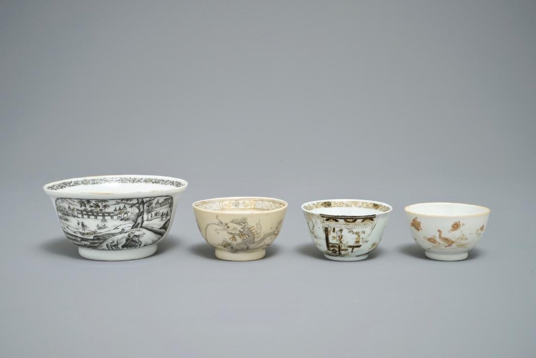 A Chinese grisaille and gilt bowl and three cups,