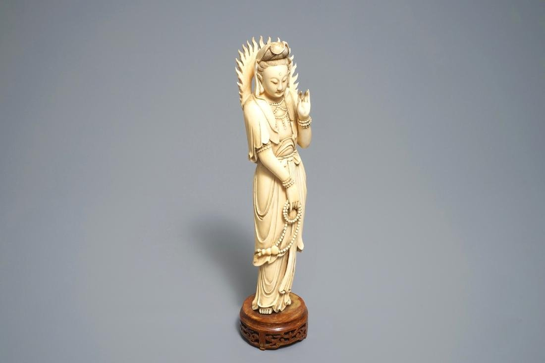 A Chinese carved  figure of Guanyin, 19th C.