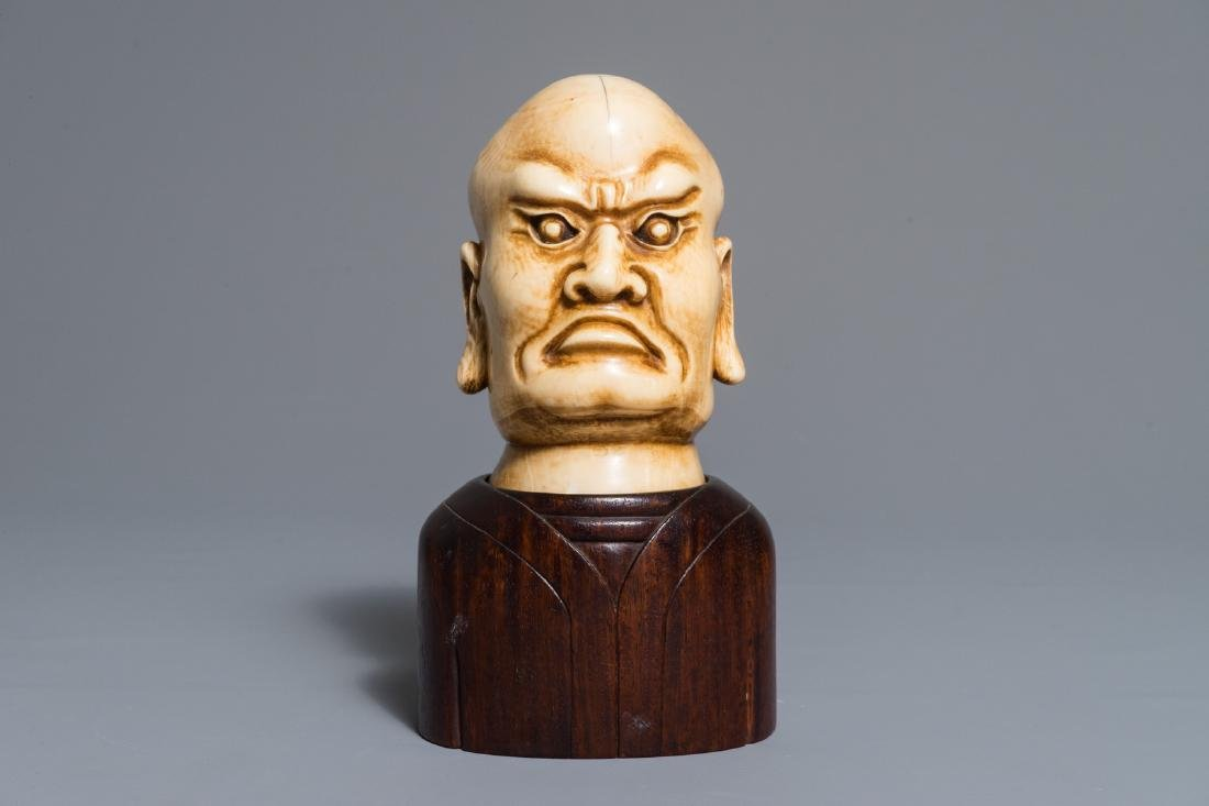A Chinese carved  Luohan head on wooden bust, 1st half