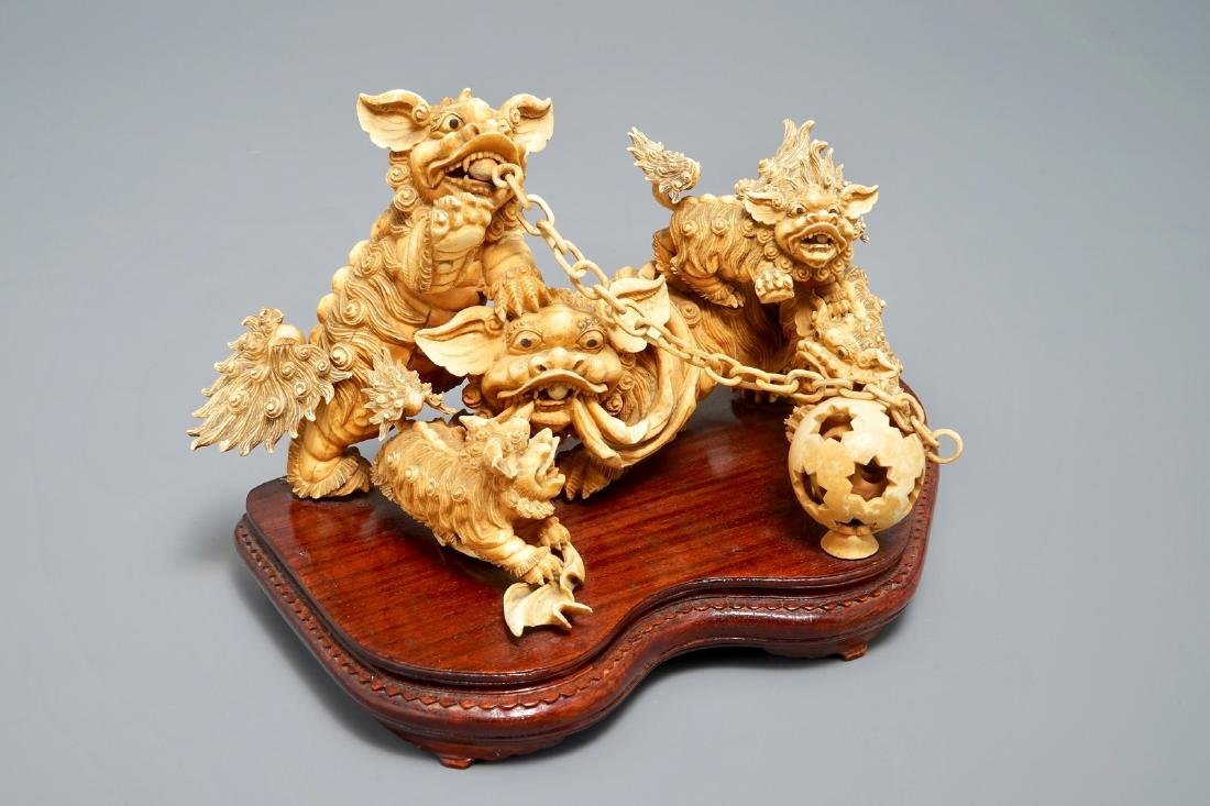 A Chinese carved  group of Buddhist lions playing with
