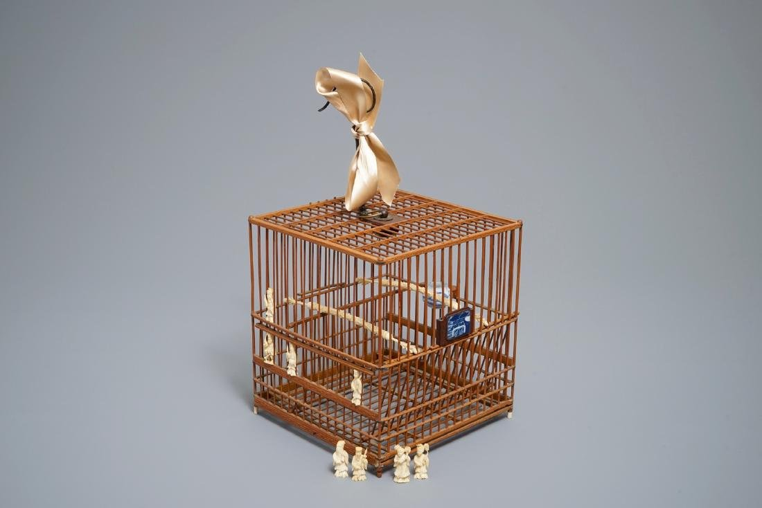 A Chinese wooden bird cage with  and porcelain