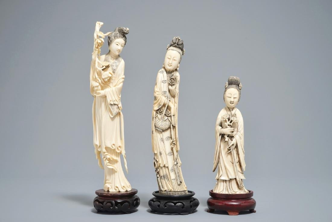Three Chinese carved  figures of ladies on wooden