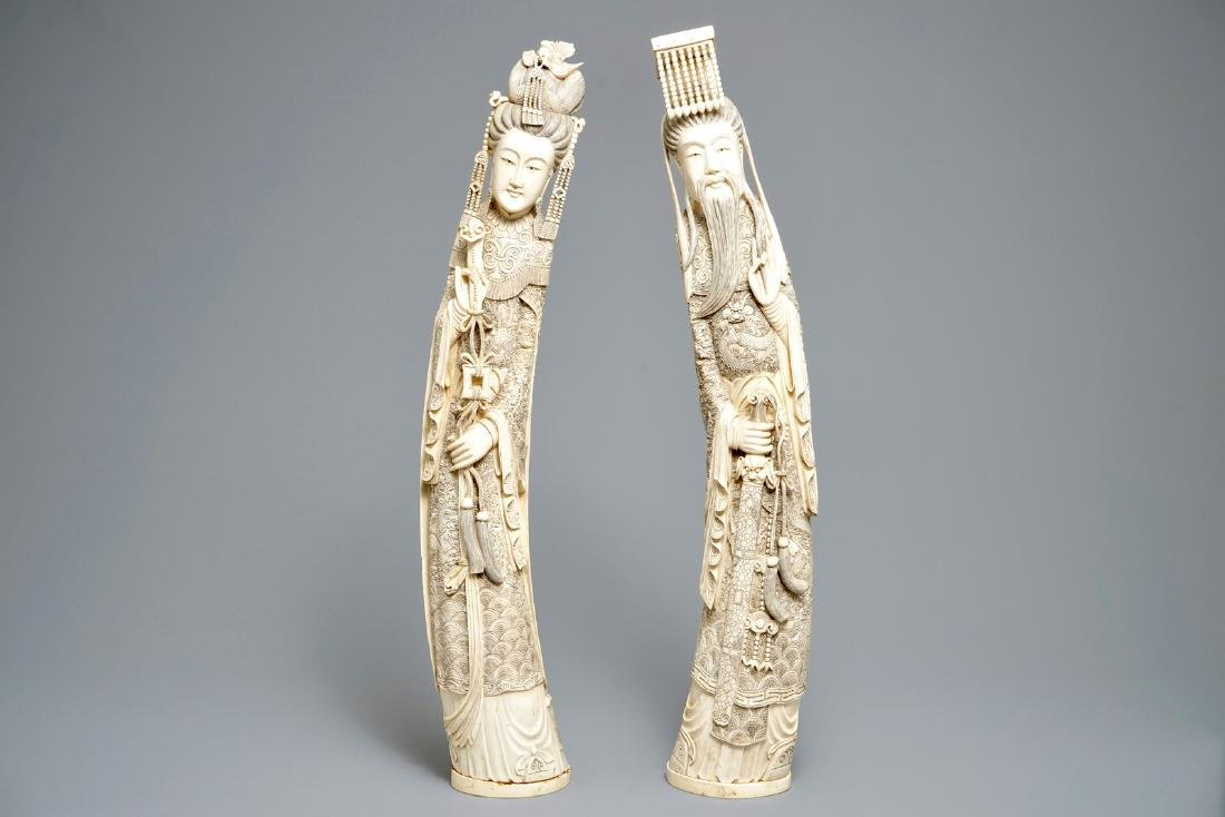 A pair of large Chinese  figures of an emperor and his