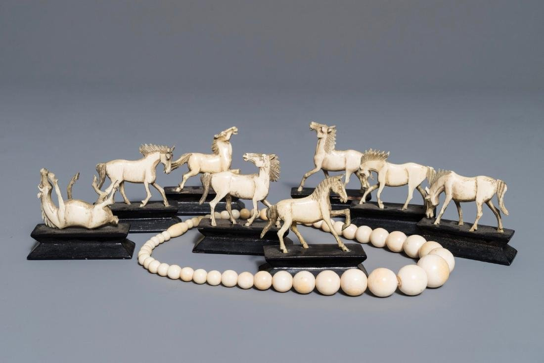 Eight Chinese carved  horses on stands and a necklace,