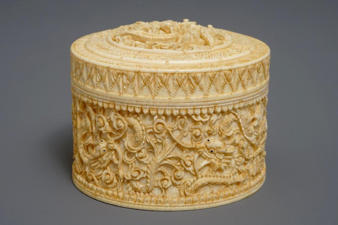 A round Chinese carved  dragon box and cover, 2nd half