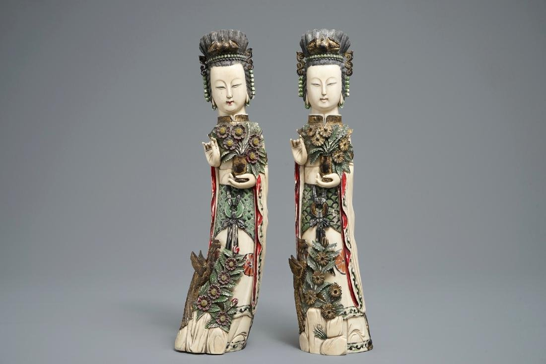 A pair of Chinese polychrome  figures of ladies, 1st