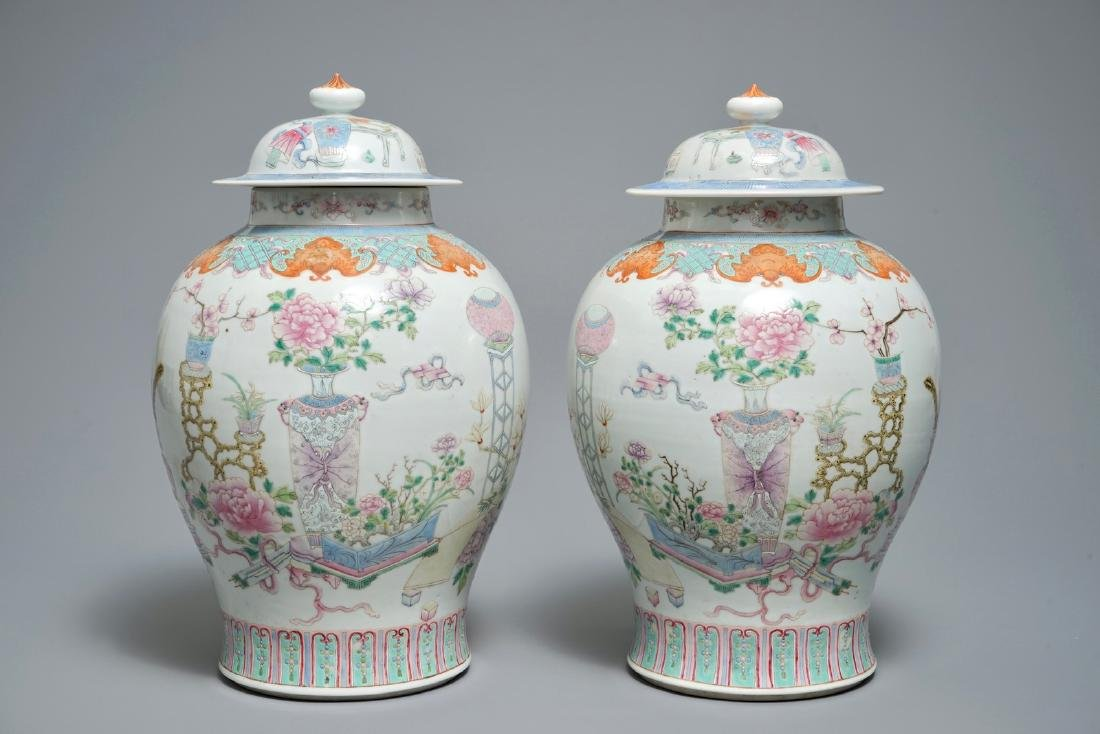 A pair of Chinese famille rose vases and covers with