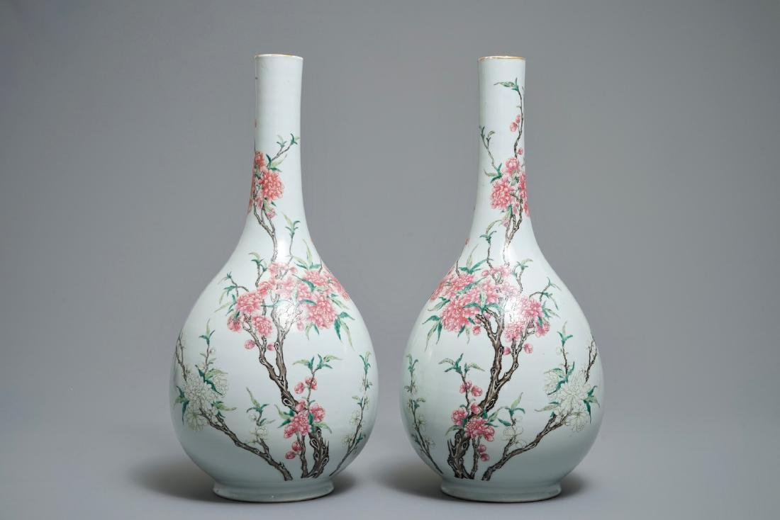 A pair of large Chinese famille rose bottle vases with