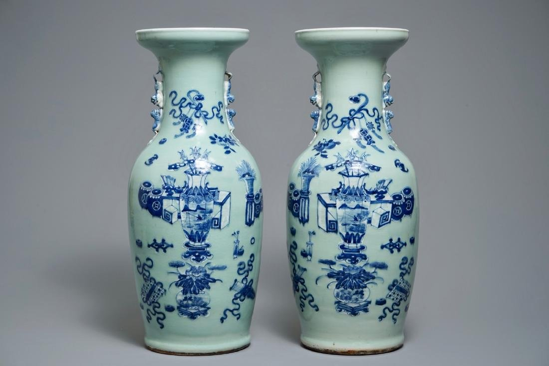 A pair of Chinese blue and white celadon-ground vases