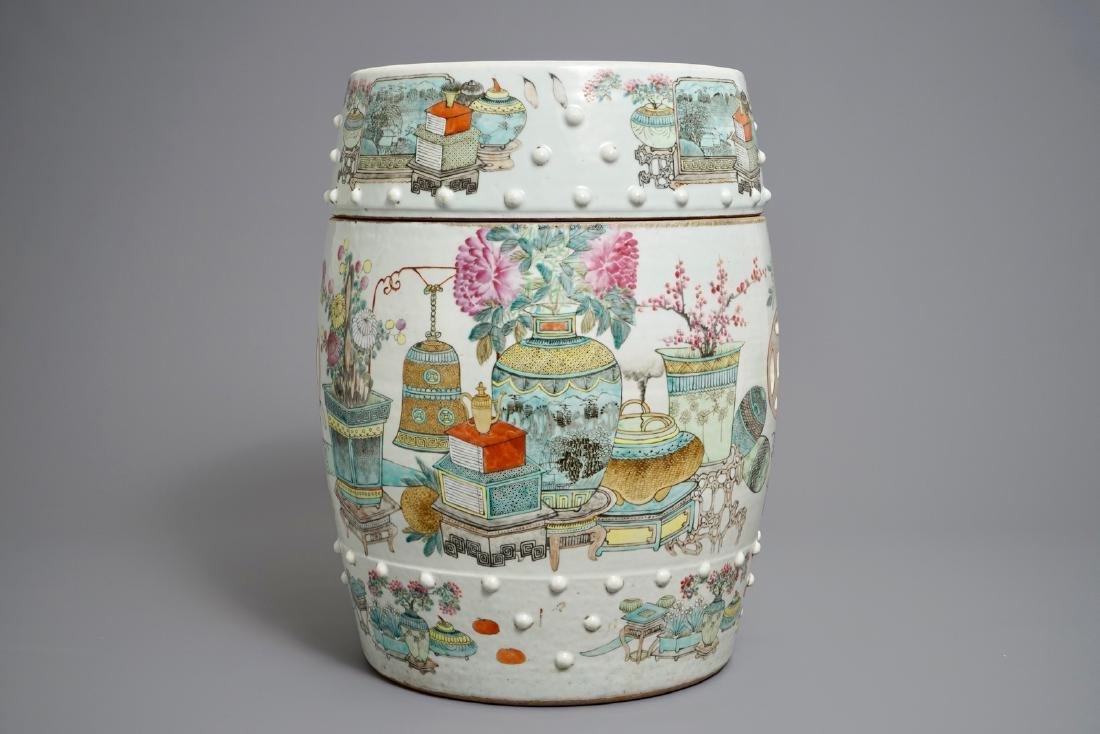 A Chinese qianjiang cai garden seat with antiquities