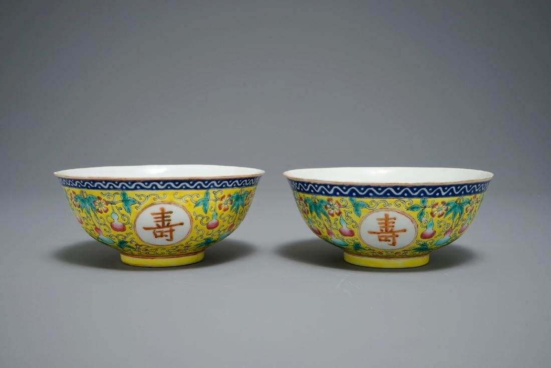 A pair of Chinese famille rose yellow-ground bowls,
