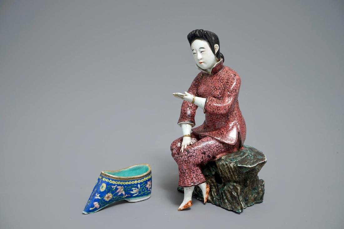 A Chinese famille rose model of a lady and a miniature