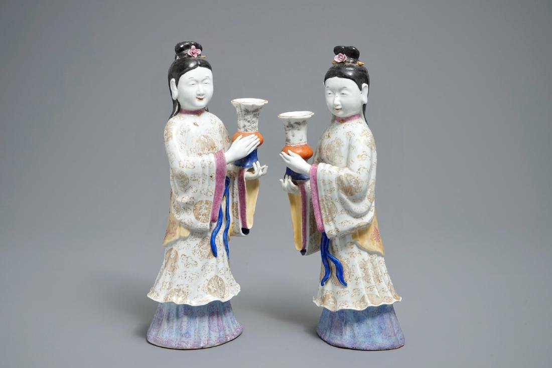 A pair of Chinese famille rose candle holders shaped as