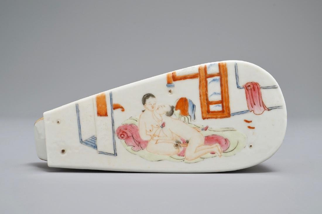 A Chinese coral-ground and gilt miniature shoe with