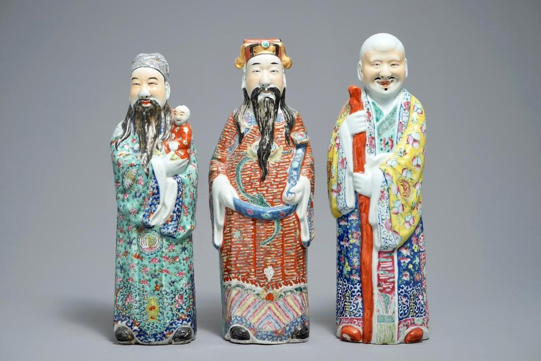 A set of three Chinese famille rose figures of