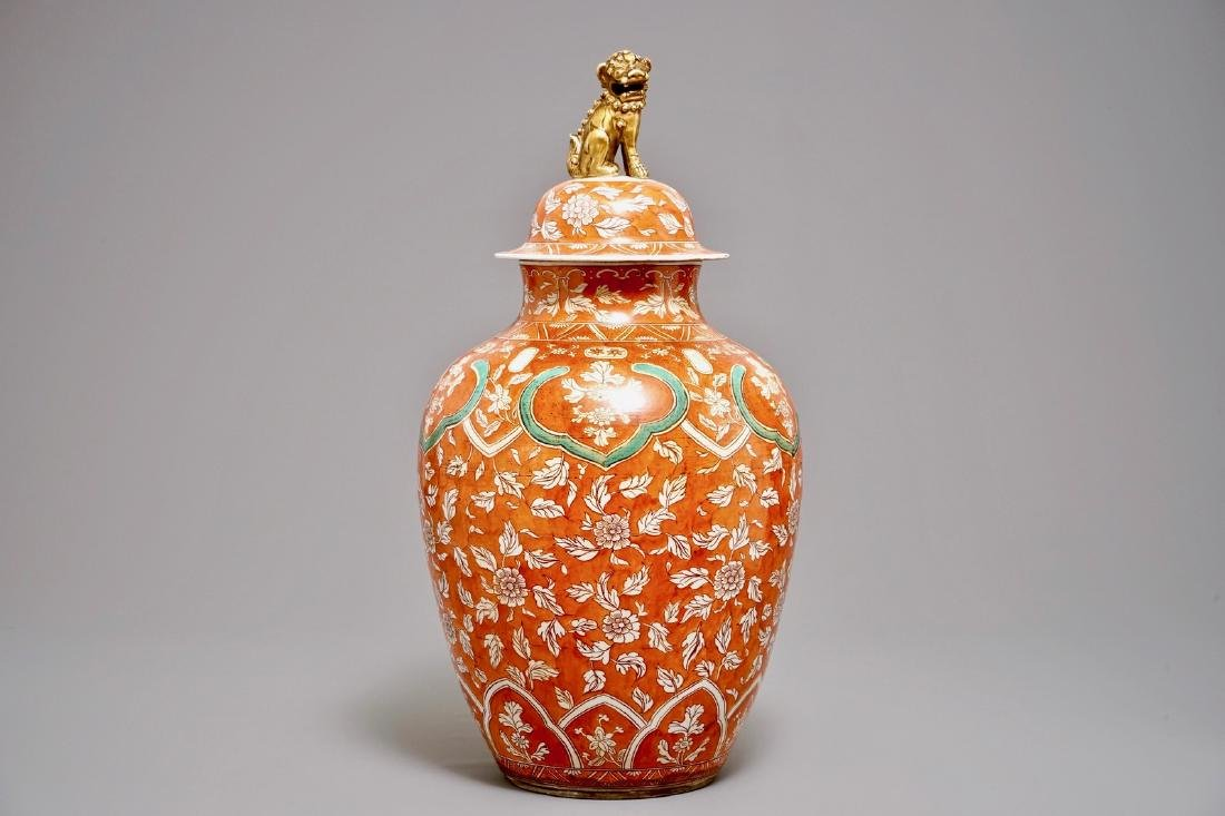 A large coral-ground vase and cover with floral design,