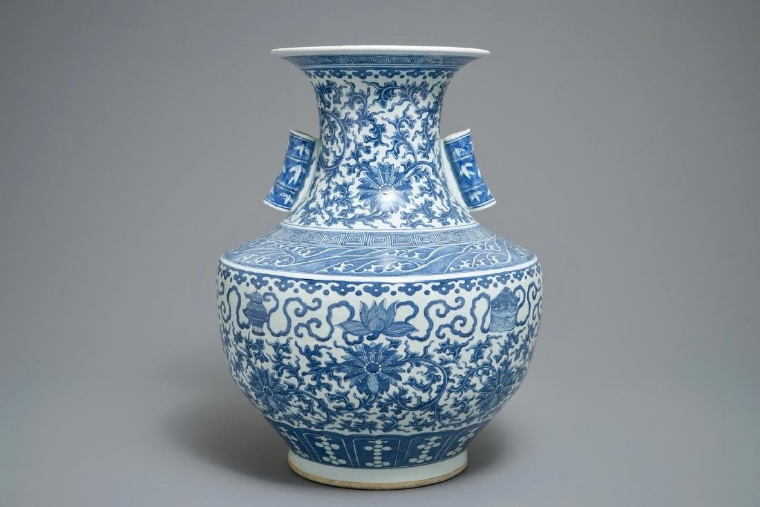 A Chinese blue and white lotus scroll hu vase, 19th C.