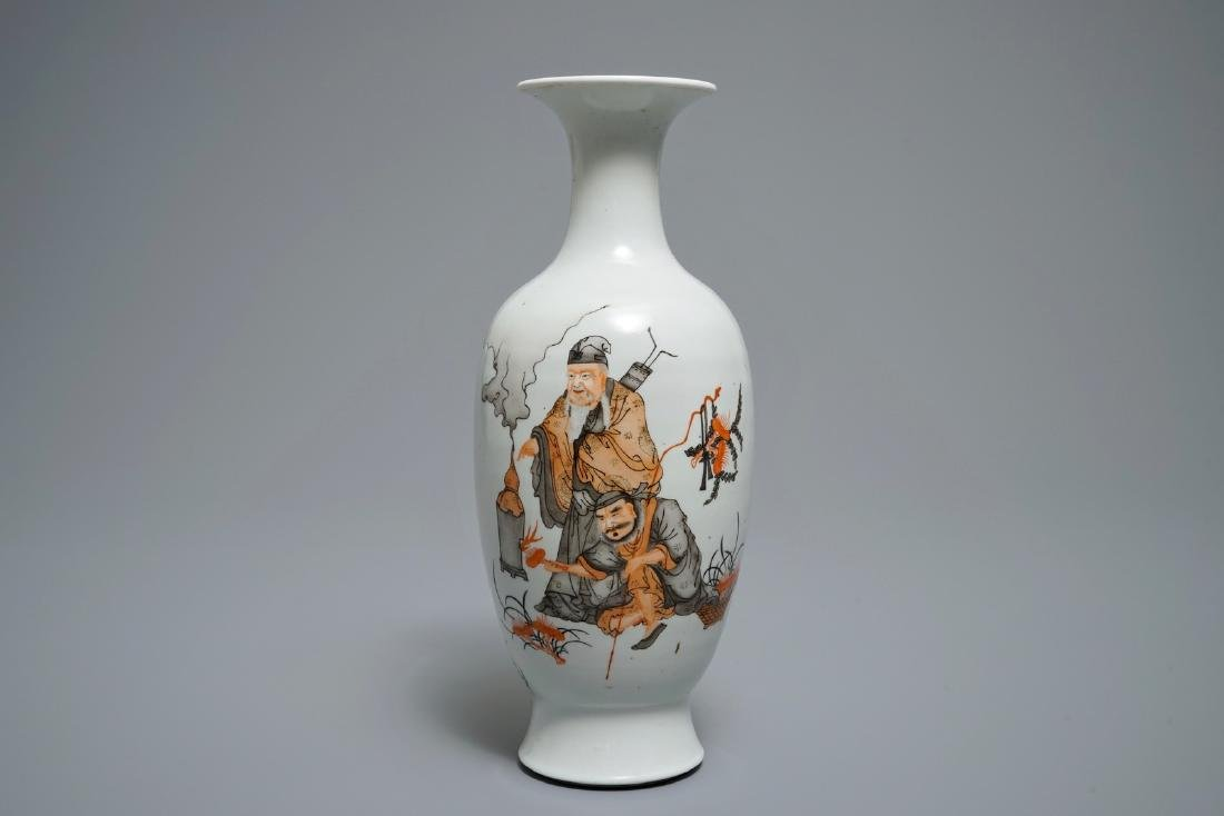 A Chinese iron red and grisaille vase with immortals,