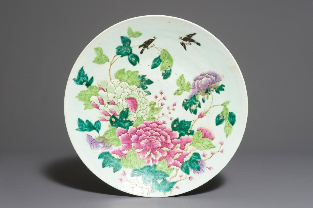 A very large Chinese famille rose dish with birds among