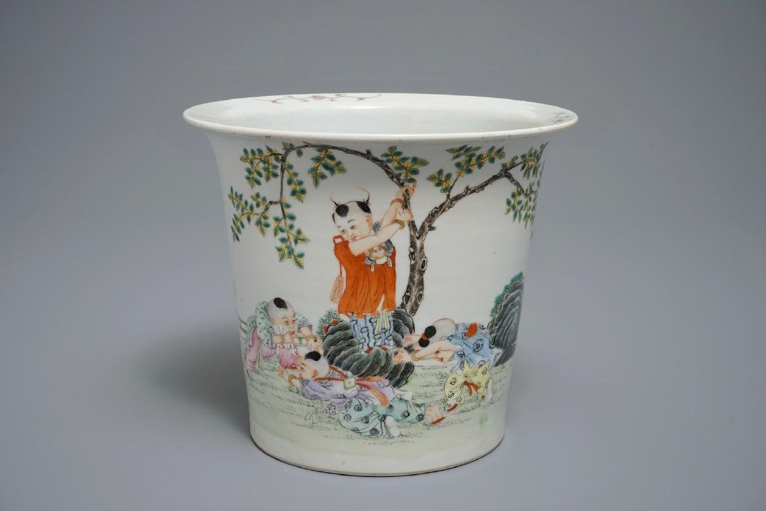A Chinese famille rose flower pot with playing boys, Ju