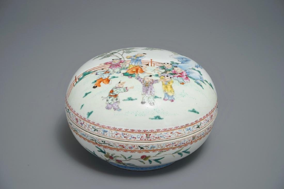A Chinese famille rose box and cover with playing boys,