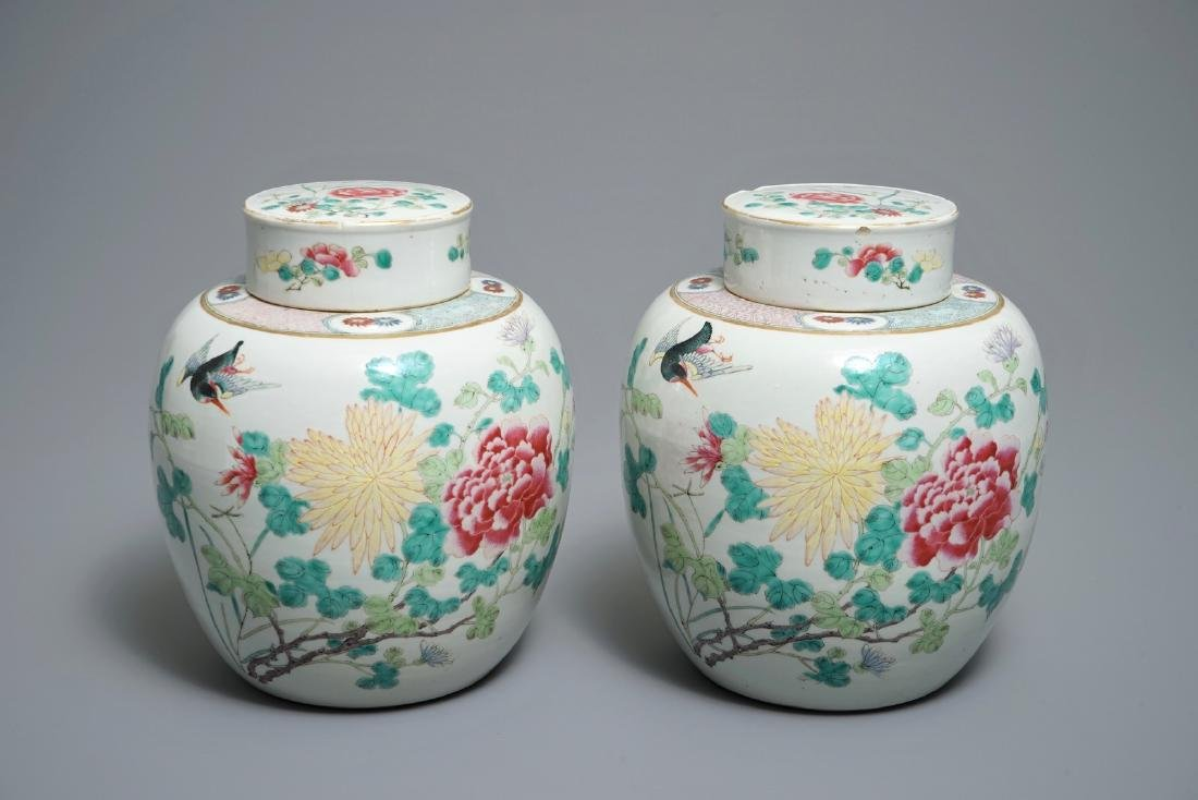 A pair of Chinese famille rose jars and covers with