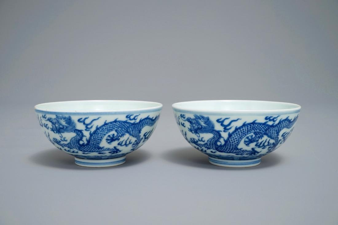A pair of Chinese blue and white 'dragon' bowls,
