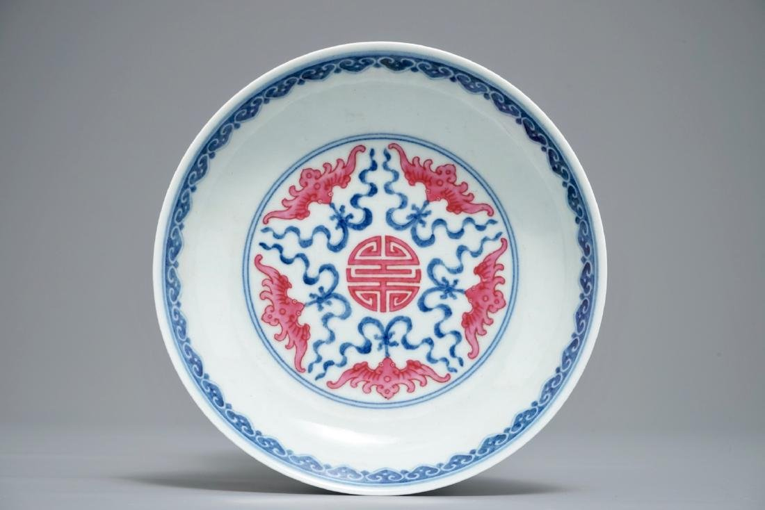 A Chinese puce-enamelled 'Bats and shou' plate,