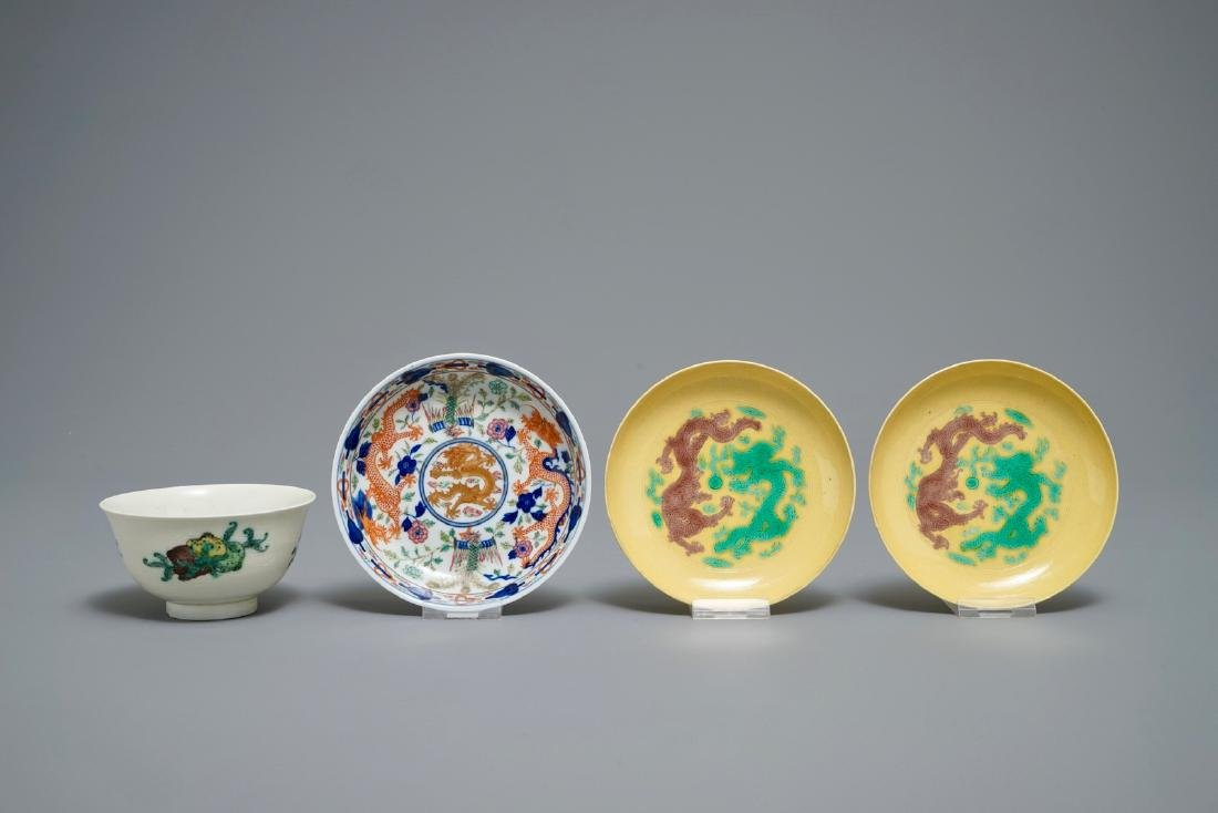 Three Chinese plates with dragons and phoenixes and an