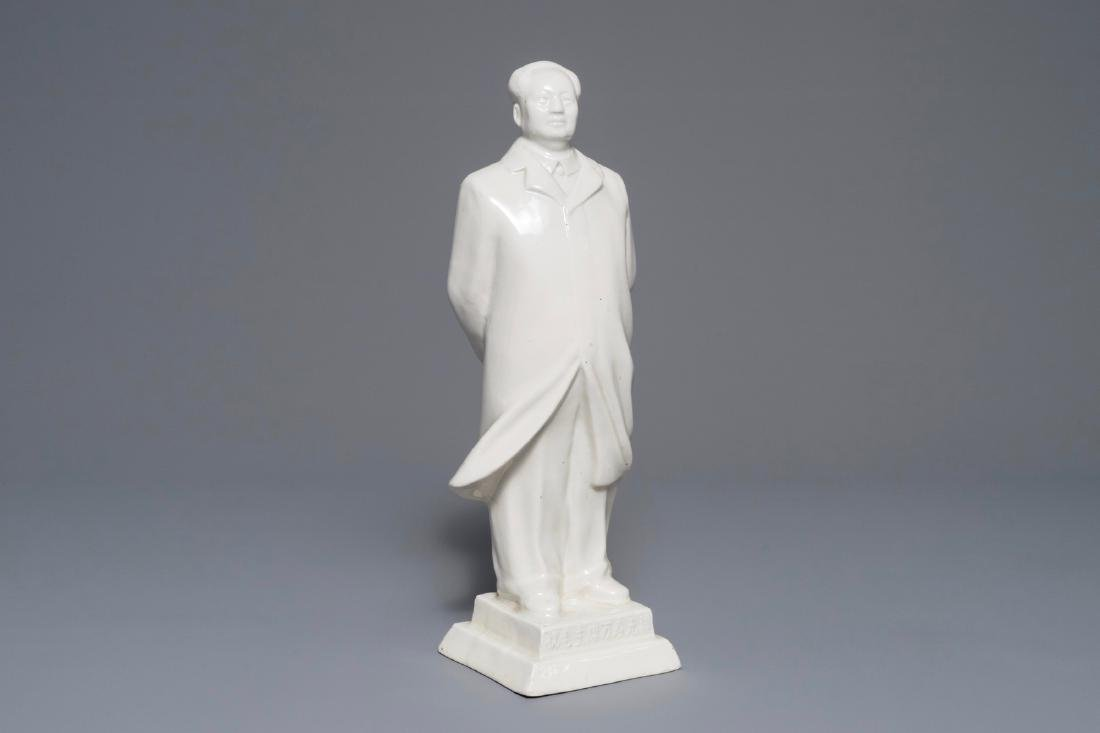 A tall Chinese figure of Mao Zedong standing on an