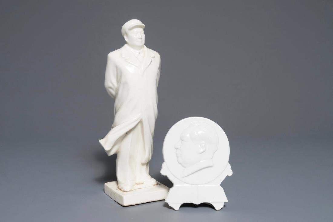 A Chinese figure of Mao Zedong with typical cap and