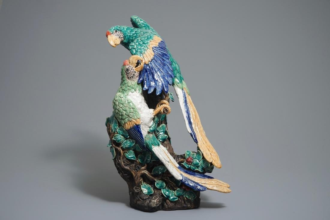 A large Chinese Shiwan pottery group of parrots,