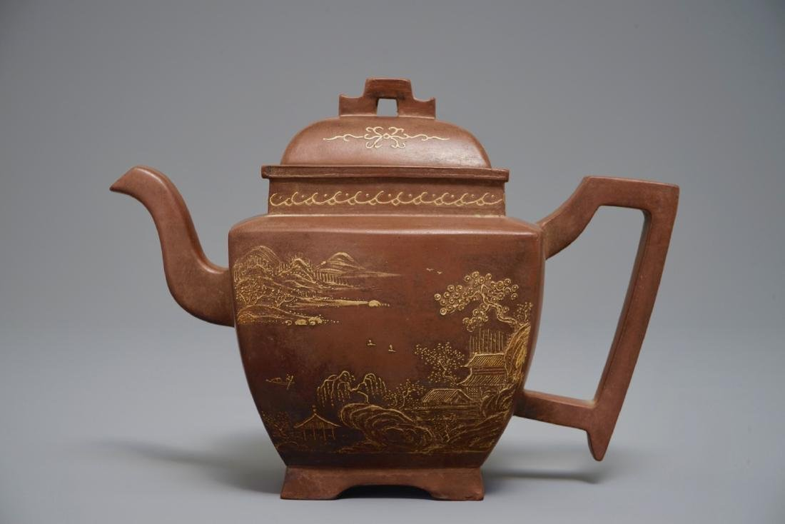 A Chinese Yixing teapot and cover with applied design,