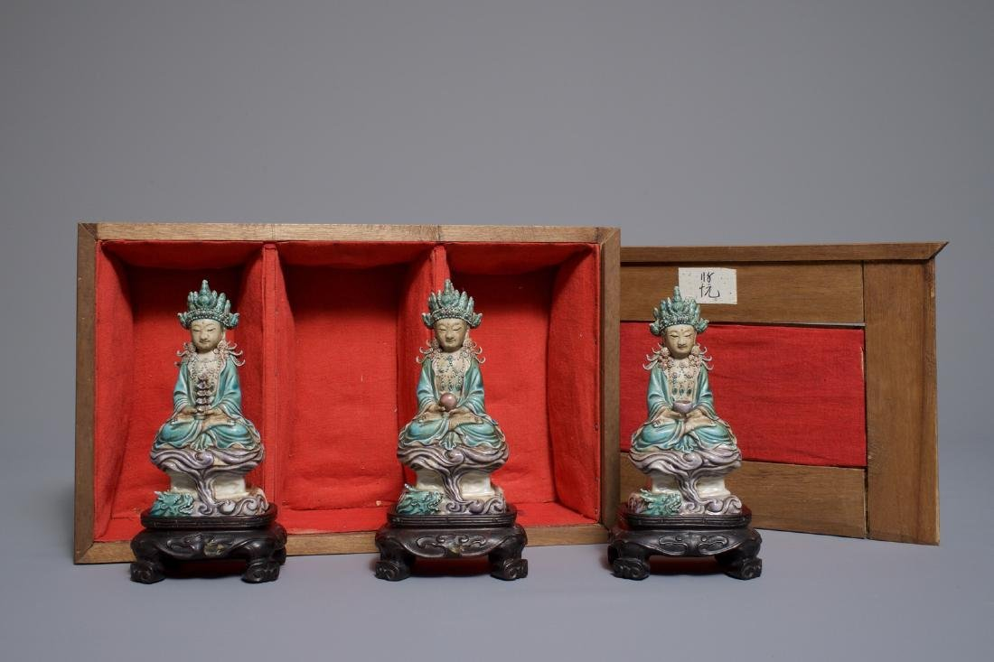 Three Chinese enamel on biscuit figures of Buddha, 19th